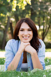 Portrait of a young brunette woman in the park royalty free stock image