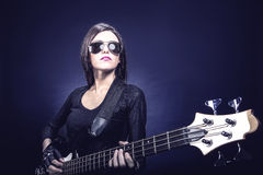 Portrait of young brunette woman playing bass Royalty Free Stock Image