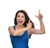 Portrait of young brunette woman pointing hands finger at corner Stock Photography