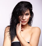 Portrait of a young brunette woman with shining wet make-up and Royalty Free Stock Photography