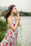 Portrait of a young brunette woman. In a summer dress in flower Royalty Free Stock Photo