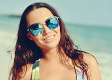 Portrait young brunette woman in sunglasees Stock Photos