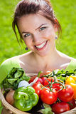 Portrait of a young brunette woman with vegetable Royalty Free Stock Images