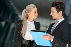 Young business couple talking with file. Stock Photos