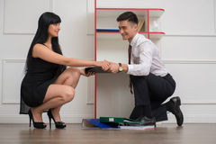 Portrait of young business couple flirting near Royalty Free Stock Images