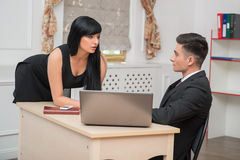 Portrait of young business couple flirting near Royalty Free Stock Image