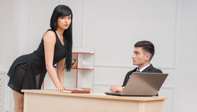 Portrait of young business couple flirting near Stock Image