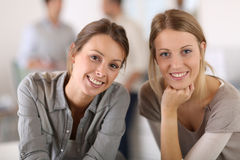Portrait of young business girls at office Stock Photos