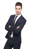 Portrait of a young business man with arms crossed. On isolated white background Royalty Free Stock Photography