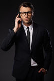 Portrait of young business man. Black background Royalty Free Stock Photography