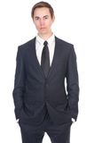 Portrait of a young business man in black suit Stock Image