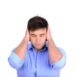 Portrait of young business man covering his ears Stock Photo