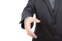 Portrait of young business man extending hand Royalty Free Stock Photos