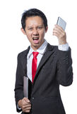 Portrait of young business man holding tablet and smartphone Stock Images