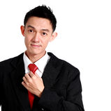 Portrait of a young business man looking at the camera while fix Stock Photo