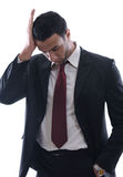 Portrait of a young business man looking depressed Royalty Free Stock Images