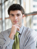 Portrait of young business man at modern office Royalty Free Stock Images