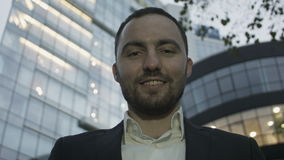 Portrait of young business man on office building stock footage