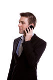Portrait of young business man on the phone. Stock Photos