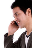 Portrait of young business man on the phone. Royalty Free Stock Images