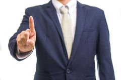 Portrait of young business man pointing up Stock Images