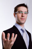 Portrait of young business man presenting and showing Stock Photos
