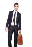 Portrait of a young business man smiling with bag. On isolated white background Stock Photos