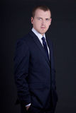 Portrait of young business man in suit over grey Royalty Free Stock Image