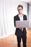 Portrait young business man in suit working with laptop Royalty Free Stock Photography