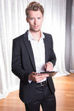 Portrait young business man in suit working with tablet Royalty Free Stock Photo