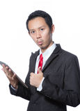 Portrait of young business man using tablet Royalty Free Stock Photo