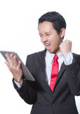 Portrait of young business man using tablet Royalty Free Stock Image