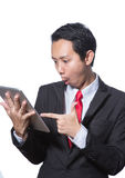 Portrait young business man using tablet thumb up hand point to tablet Stock Photography