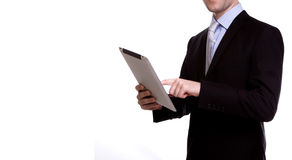 Portrait of young business man using a touch screen device Stock Image