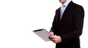 Portrait of young business man using a touch screen device Royalty Free Stock Photography