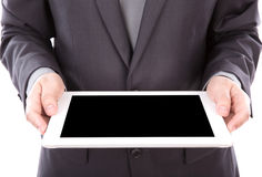 Portrait of young business man using a touch screen device Stock Photos