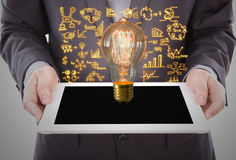 Portrait of young business man using a touch screen device Royalty Free Stock Image