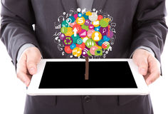 Portrait of young business man using a touch screen device Royalty Free Stock Images