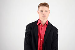 Portrait of a young business man wearing a suit and a red shirt. Royalty Free Stock Photography