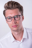 Portrait of a young business man in white shirt royalty free stock photography