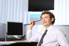 Portrait of a young business man working at office Royalty Free Stock Photos