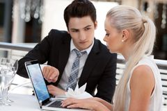 Business partners working on laptop at restaurant. Stock Photo