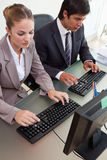 Portrait of young business people working with computers Royalty Free Stock Images
