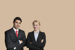 Portrait of young business team with arms crossed over colored background royalty free stock photography