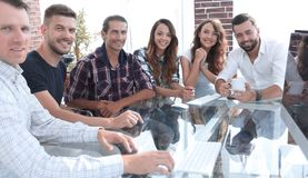 Young business team sitting at Desk royalty free stock images