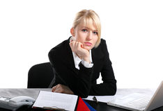 Portrait of the young business woman. Sitting at a desktop Stock Photography