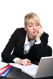Portrait of the young business woman. Sitting at a desktop Stock Photos