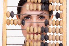 Portrait of young business woman with abacus Royalty Free Stock Photography