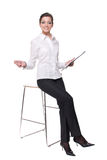 Portrait of young business woman on chair Stock Photos