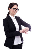 Portrait of young business woman checks time on her wrist watch Stock Images